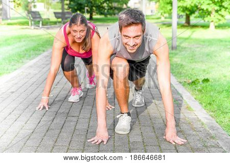 Handsome Athletic Man and woman in Running Start Position