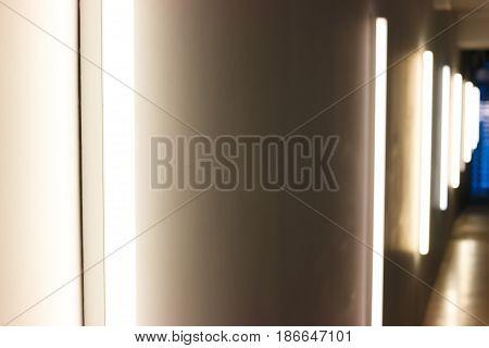 A Dark Corridor, Lit By Vertical Lamps.