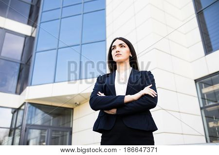 Beautiful Young Businesswoman Against The Skyscrapers Of The Modern Business Center