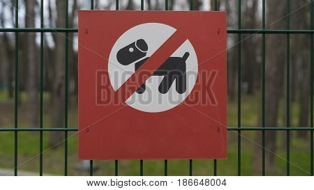 sign banning dog walking dogs not allowed