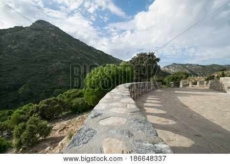 a stone path leading into the mountains in Marbella, Spain