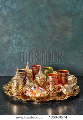 Arabic tea coffee table golden dishes. Oriental hospitality. Ramadan kareem. Eid Mubarak