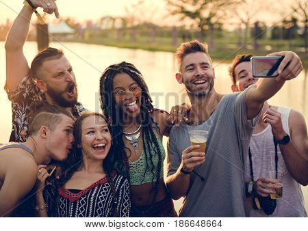 Group of Diverse Friends Enjoying Taking Selfie Photo at Live Music Concert Festival