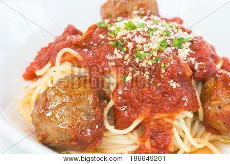 Beef and Lamb meatball pasta over white background