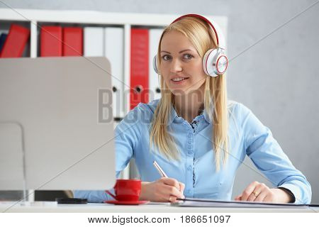 Business Woman Studying Online. Listens Lecture Looks At Camera.