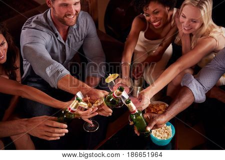 Friends making a toast at a party, close up, elevated view