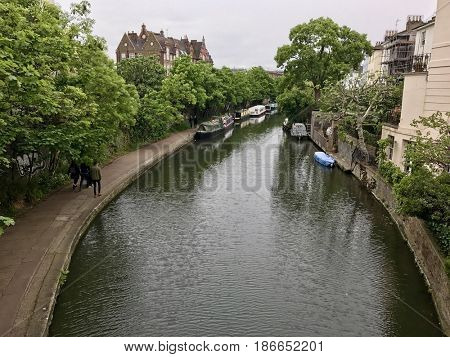 LONDON - MAY 15, 2017: The Regents Canal in Primrose Hill towards Camden Town in London, UK.
