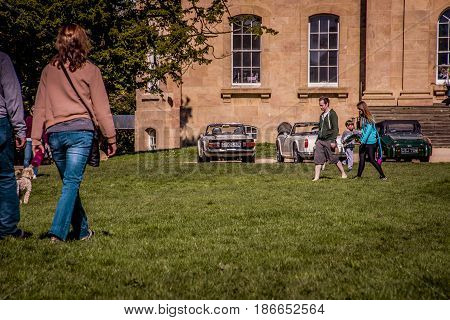 Bristol UK - April 02 2017: peolple walking to Kings Weston House entrance front across the lawns. Kings Weston House is a historic building in Bristol England. It was built between 1712 and 1719 was designed by Sir John Vanbrugh.
