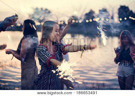 Woman Enjoying Sparkler in Festival Event