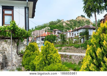 Street view with traditional bulgarian houses with terrace from the Revival period in Melnik town, Bulgaria