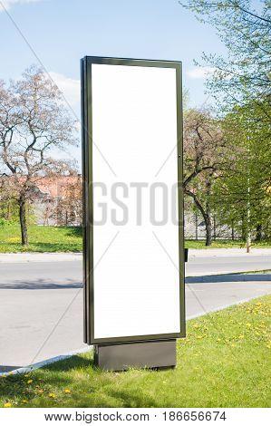 Advertising column mockup. Blank public information board mock up near city park