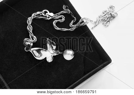Silver butterfly pendant with white pearl in black jewel box