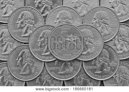 Texas State and coins of USA. Pile of the US quarter coins with George Washington and on the top a quarter of Texas State.