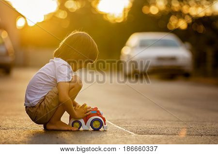 Two Sweet Children, Boy Brothers, Playing With Car Toys On The Street In Village On Sunset