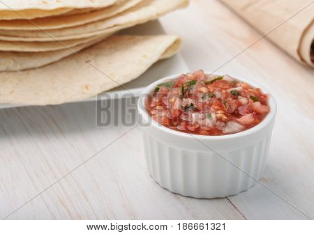 Ramekin with salsa fresca sauce and flatbread
