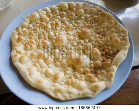 COLOR PHOTO OF FRESH PLAIN NAAN ON PLATE