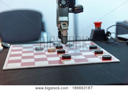 High-tech robot plays checkers at an exhibition of robotics