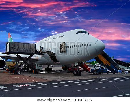 Jumbo Jet on the ground, getting loaded