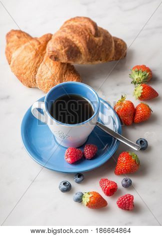 breakfast with coffee brioche and berry fruits