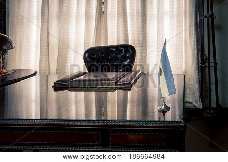 Polished business desk with a shine with an Argentina flag