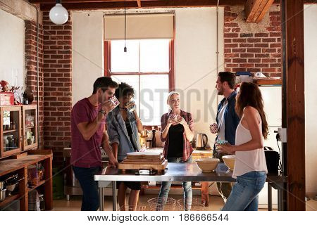 Five friends having coffee in kitchen, three quarter length