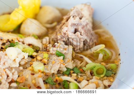 Closeup of noodle soup. Asian Food style. Chicken noodle and soup in bowl delicious local food in Thailand. Street food.