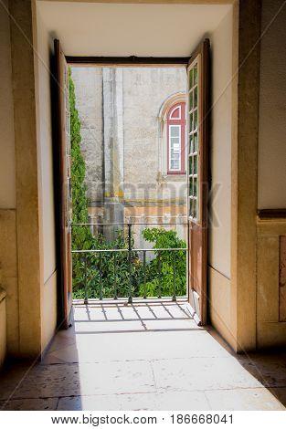 window balcony doorway entrance with sunlight shining through