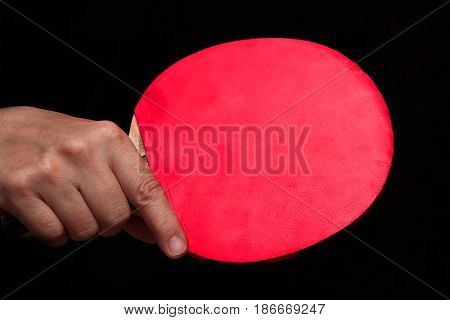 Held Backhand In Shake Hand Style For Table Tennis.