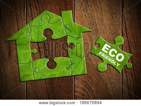 Eco friendly house concept home made from green puzzle