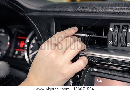 Adjusting The Air Vent Of A Car