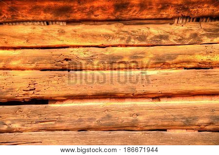 Several old and weathered wooden planks laid horizontally.