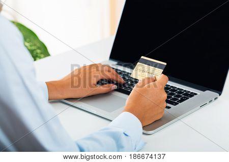 Credit card computer laptop computer keyboard closeup notebook computer typing