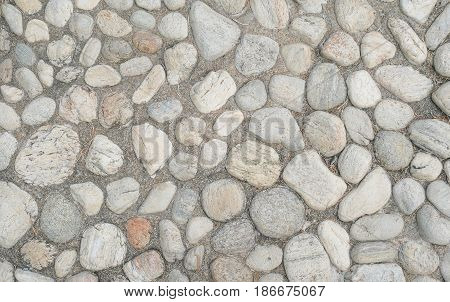 Close up stone floor with cement was buried. Floor decorated with stone it has the distinction of stone color.
