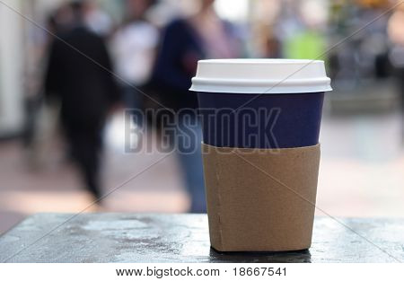 blue cup of coffee on a street background