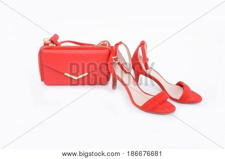 Fashion concept. Red handbag , red shoes on a white background