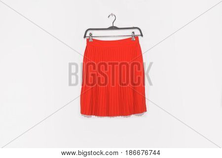 Red skirt on hanging isolated