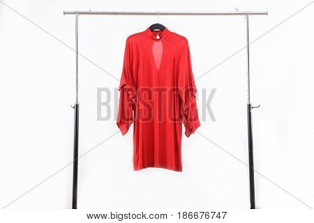 Red sundress on hanger isolated