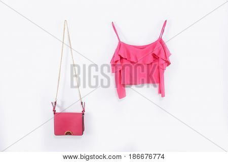 Pink handbag ,,shirt on a white background