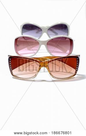 Three sunglasses on white background