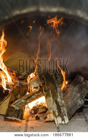 Birch wood burning in the Russian oven.