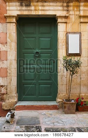 Door of a building in the old town of Chania on Crete island, Greece.