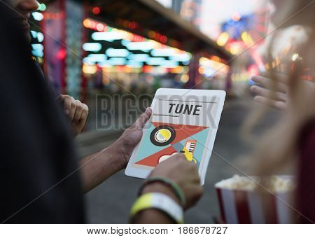 Group of people listening to leisure music activity on digital tablet