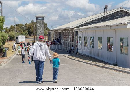 ROBBEN ISLAND SOUTH AFRICA 18 December 2016: Llittle boy and grandfather visiting the maximum security prison on Robben Island where Nelson Mandela was imprisoned - Illustrative editorial image