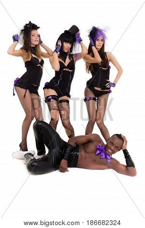 Three women in sexy lingerie and one man, full length portrait isolated over white background.