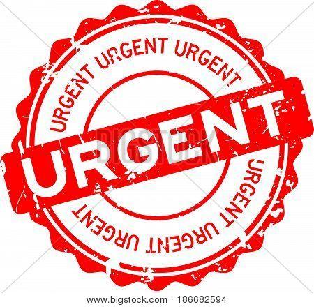 Grunge red urgent round rubber seal stamp on white background