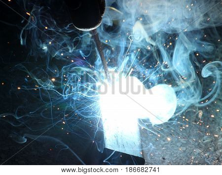 Sparks And Jets Of Smoke When Welding