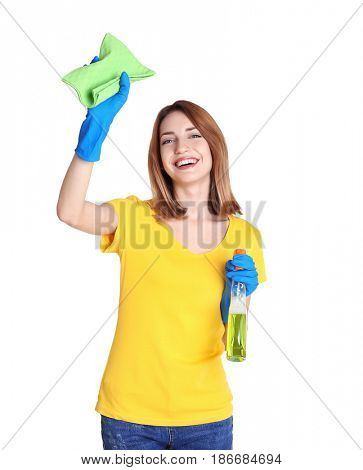Beautiful young woman holding rag and cleanser spray on white background