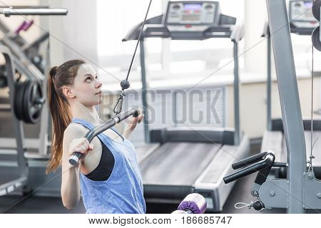 Young girl doing exercise on the upper block.