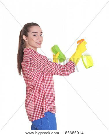 Beautiful young woman holding sponge and cleanser spray on white background