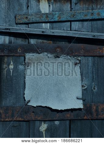 Dark rusty grunge frame nailed down on wooden background
